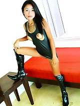 Thai teen model wears a rubber mini skirt and shows off her perky little tits