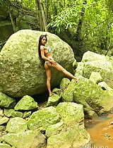 Hot Asian Tailynn in a skimpy bikini by the waterfall