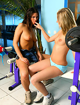 Blonde and brunette vixens strip